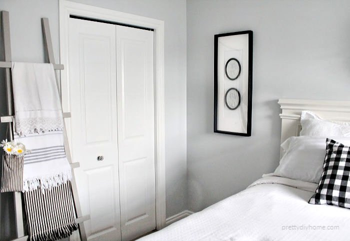 DIY bedroom ideas including a hand made bed, DIY cameo art and a wood blanket ladder.