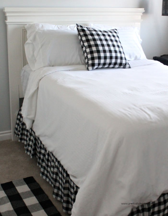 DIY Farmhouse handmade wooden farmhouse bed in a white painted finish with buffalo check bedding.