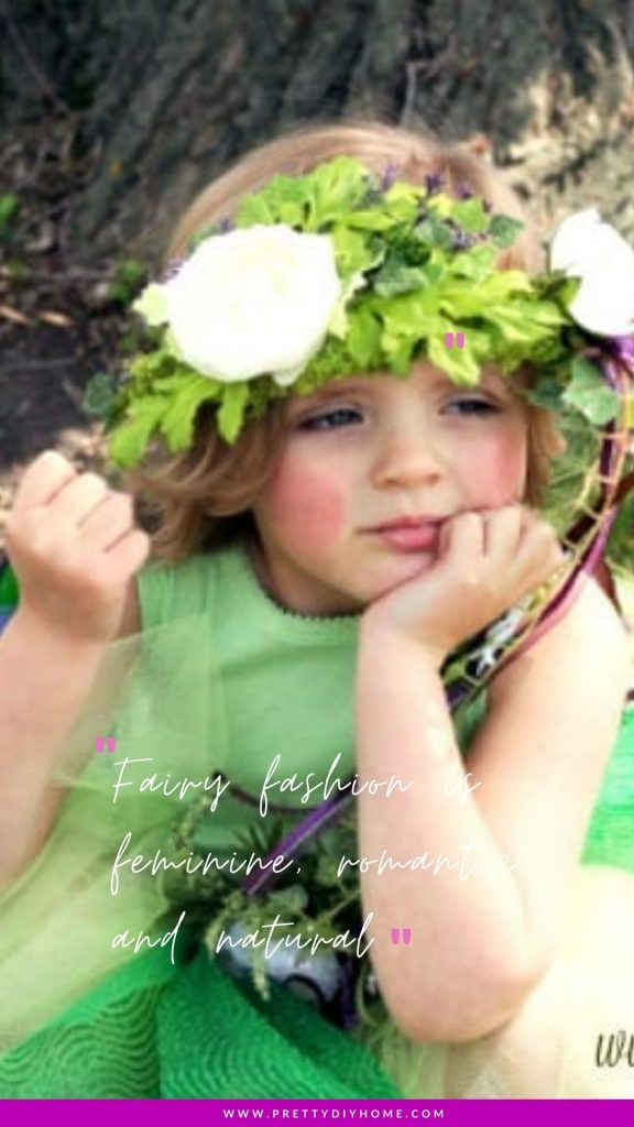 A little girl sitting in front of a tree wearing a woodland fairy crown.