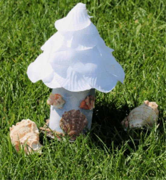 A fairy hut made with paper, dollar store supplies and shells.