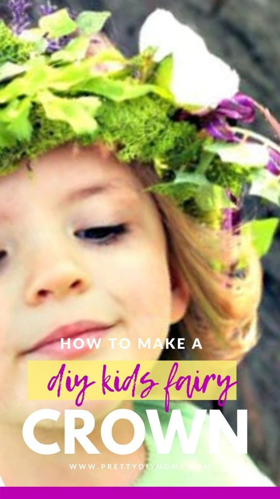 A little girl wearing a Kids DIY Fairy Crown with white flowers and ivy hanging down the side.