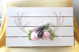 Home made antler art with fabric flowers.
