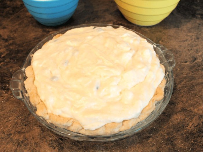Blueberry lemon chiffon pie baked and cooling.