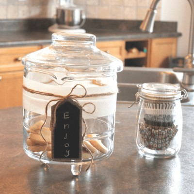 A simple farmhouse style cookie jar makeover using twine and burlap.