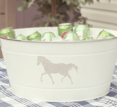 Bucket makeover with white paint and grey horse stencil.