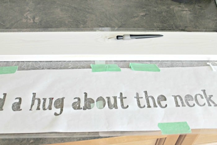 How to stencil letters on a wood DIY farmhouse sign for kids. Cutting the lettering using a Silhouette.