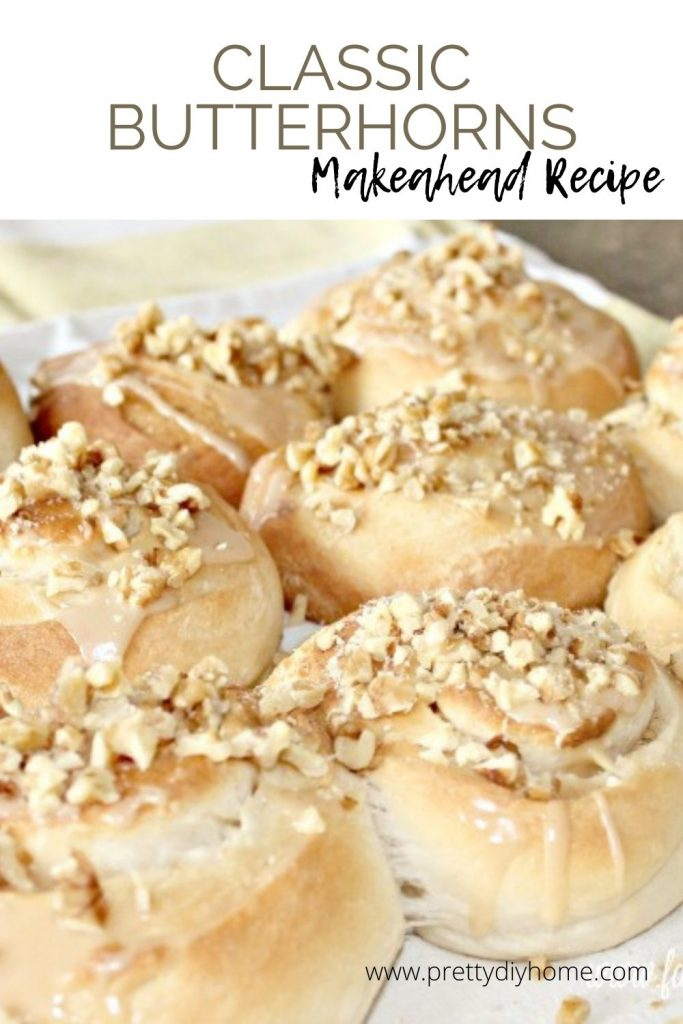 Classic butterhorns on a tray with vanilla glaze and walnuts.