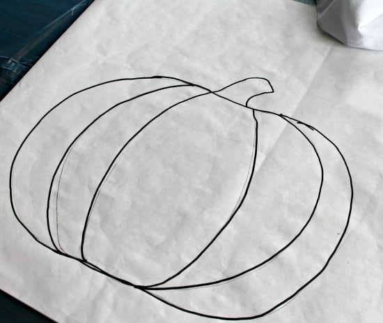 Outline of a pumpkin as part of how to paint a pumpkin on a pillow cover.