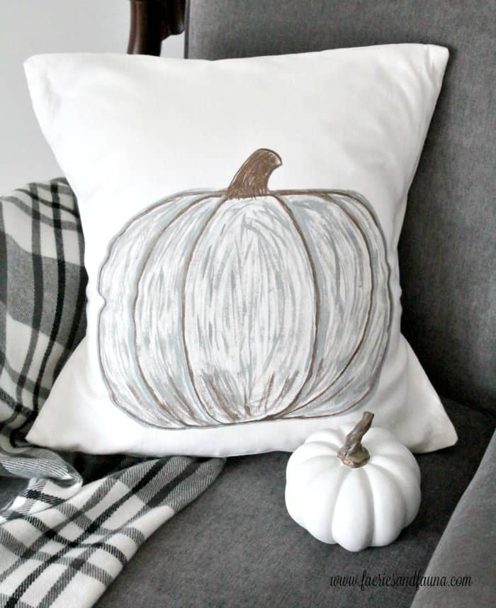 Pretty DIY cushion cover with painted pumpkin for fall decorating.