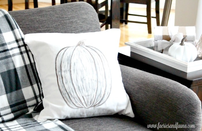 Painted Pumpkin on DIY Pillow Covers for Neutral Fall Decor.
