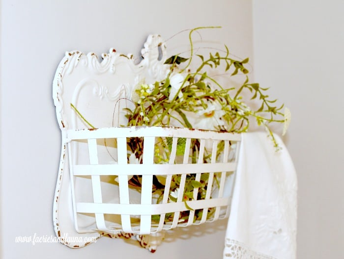 A vintage white metal basket hanging next to the DIY Farmhouse window shelf to add colour and style. DIYwindow shelf, DIYwindow rod, DIYwindow treatment,