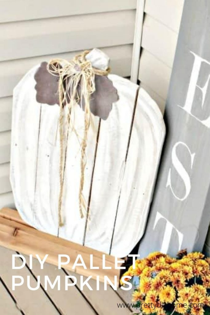 Large wood DIY Wood Pumpkin for the front porch. In white with a grey sign and gold flowers.