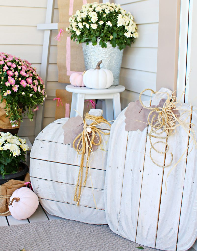 DIY pallet pumpkins for cheap Fall front porch decor.