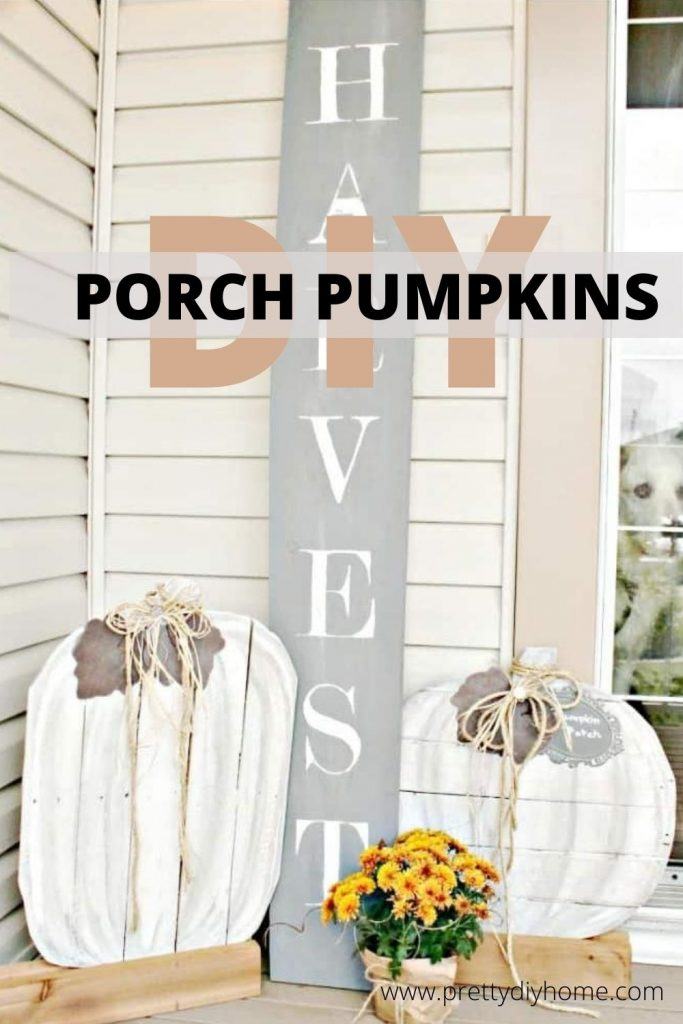DIY Neutral Pallet Wood Pumpkins in White with grey leaves on a Fall Front Porch