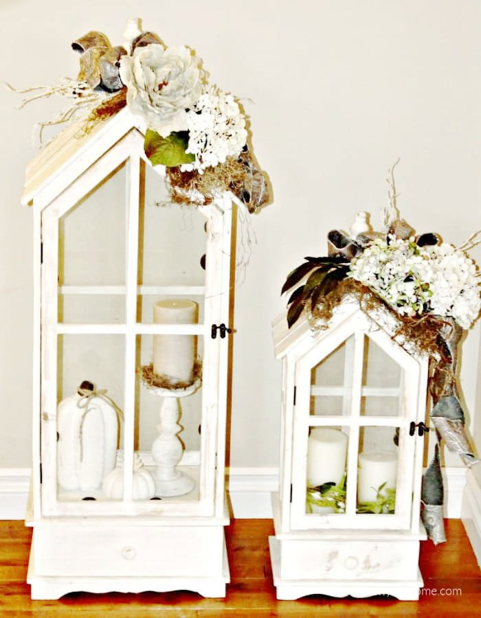 Two large white Fall lanterns with DIY neutral flower arrangements. New Fall Decorating Ideas for home decor.
