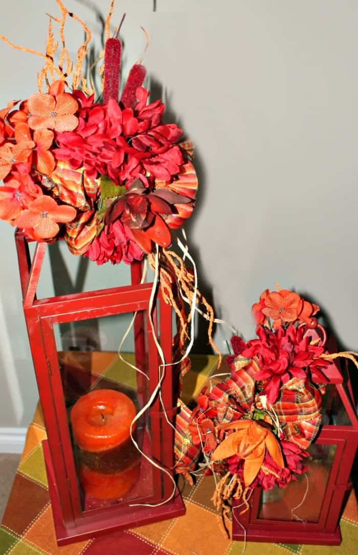 Traditional fall decor with lanterns ribbon and flowers. DIY home decorating idea for fall.