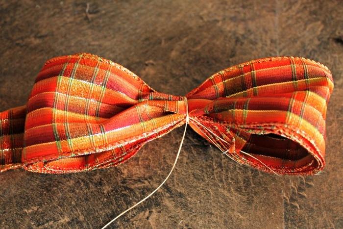 Folding ribbon for a DIY fall lantern idea. Pretty fall decorating.