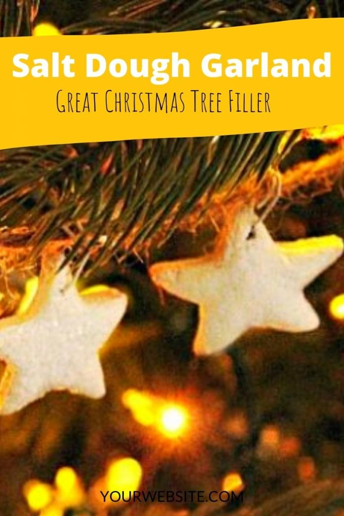 Sparkling handmade Christmas tree garland with white stars and twine.