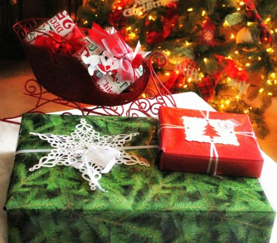 Various size and styles of wrapped Christmas presents, for in the mail.