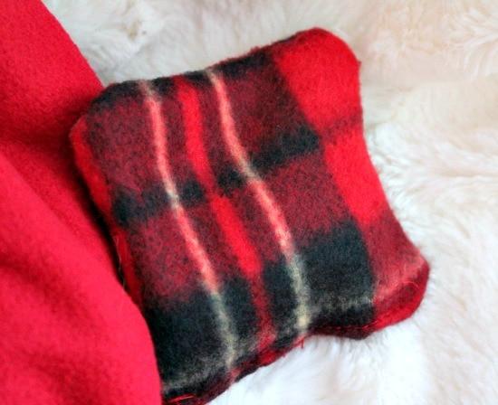 Handmade hand warmers, an easy DIY Christmas gift, made using plaid fabric.