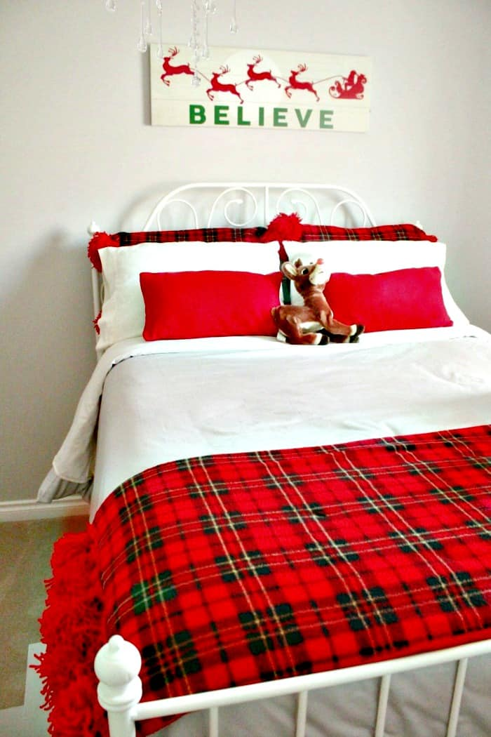 A bed decorated for Christmas with hand made DIY Christmas Cushions. DIY Christmas Cushion Covers, sewing, diy cushions, Christmas cushions, Christmas Cushion Covers, Christmas decorating,