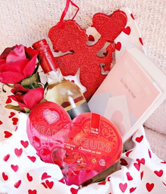 A unique Valentines Gift idea for a single girlfriend. A cute Valentines idea, with a valentine, box of chocolates, comical book and wine