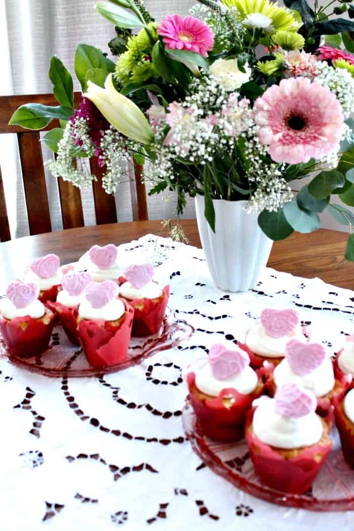 Valentine cupcake recipe with cranberry filling and fondant heart toppers.