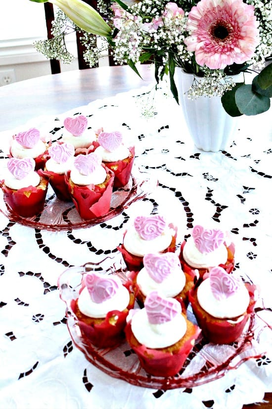 Homemade Valentine cupcake recipe with fondant hearts toppers, cranberry filling and cream cheese icing with Gran Marnier