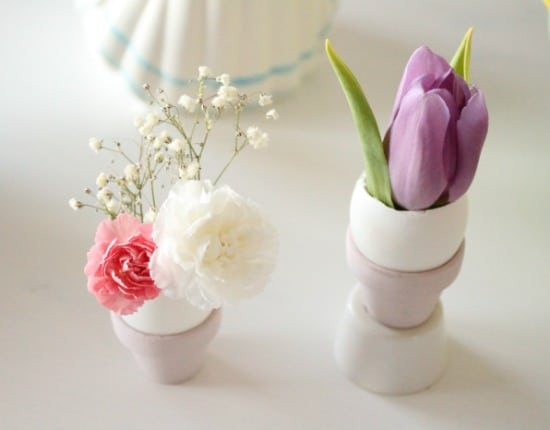 Decorating Easter eggs for place setting. Individual egg vases with Spring flowers for an Easter tablescape