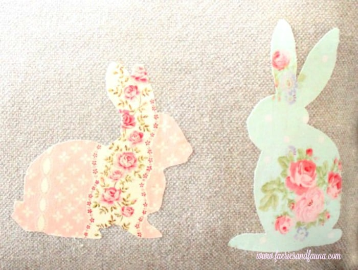 Spring cushion applique of two bunnies on a diy cushion cover, or throw pillow.