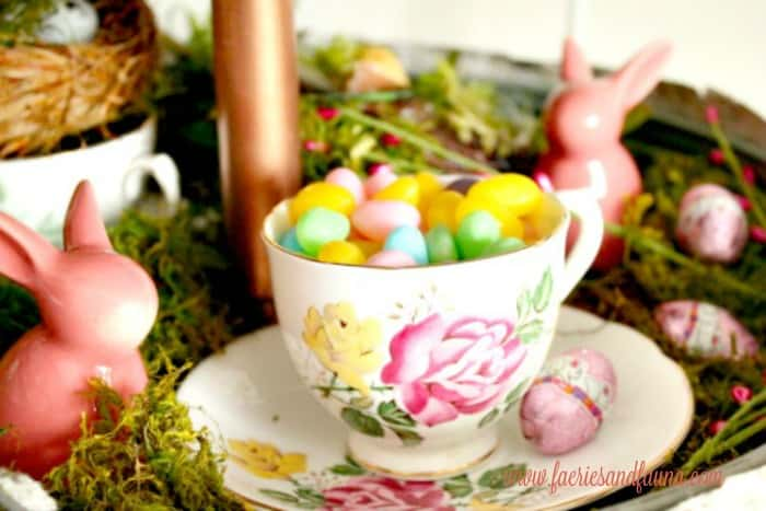 Candy in a teacup as part of a mini Easter egg hunt for Spring or Easter decorating ideas.