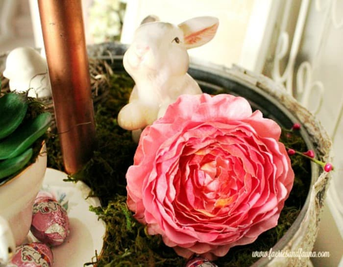 DIY Spring décor with a three tier tray, flowers and miniature bunnies. A bright and cheerful Spring display.