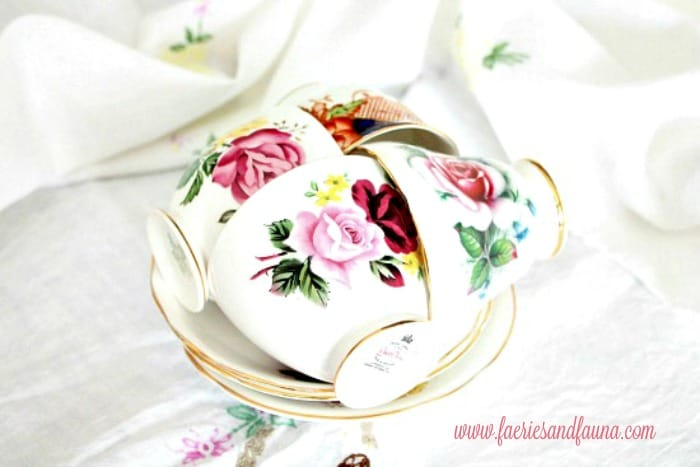 Pretty antique teacups with flowers for a Three tier tray for spring, How to decorate a tiered tray with items you already have.