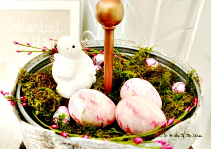 A Spring tray decorated with a bunny , Easter eggs and moss. Simple and easy Spring decor ideas with items from around your home.