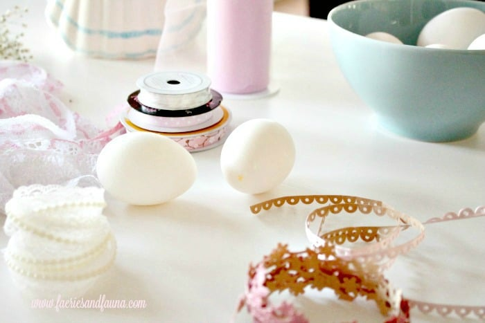 Supplies for making pretty shabby chic Easter eggs. How to hollow natural eggs, and decorate with ribbon lace and paper flowers.