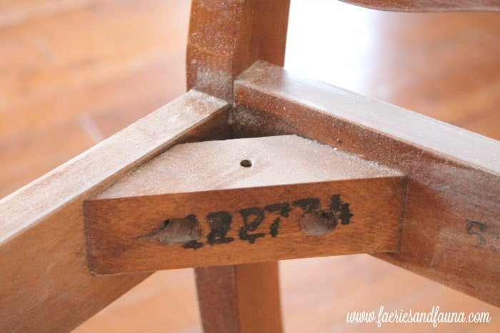 A shabby chic chair refinishing project where the registration label is protected on the inside of the chair brace.