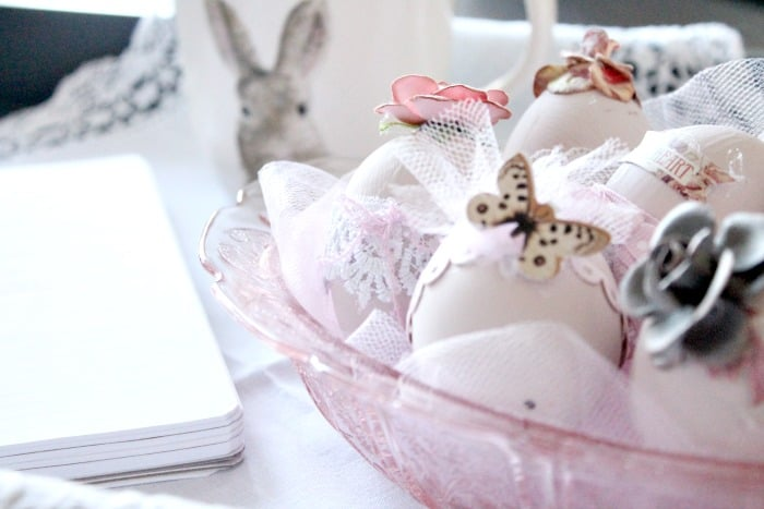 Shabby chic Easter egg decorating idea in pinks with flowers, butterflies, and lace.