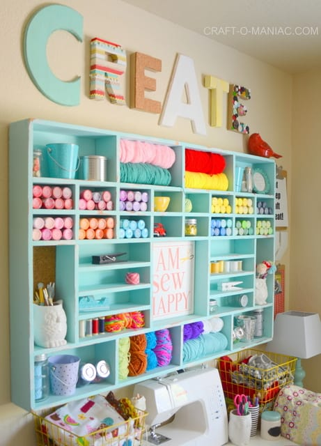 Very bright and pretty storage shelves for a craft room sewing room, or hobby area. Its turquoise with shelves for wool, paints, jars and bins. Craft room ideas, craft room ideas on a budget, hobby room idea, sewing room idea, craft area ideas,craft room inspiration, home office craft room ideas.