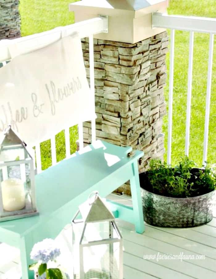 A turqoise bench and soft cushion on a diy small front porch. porch, small front porch ideas, porch ideas, front porch ideas, front porch, front porch decorating ideas
