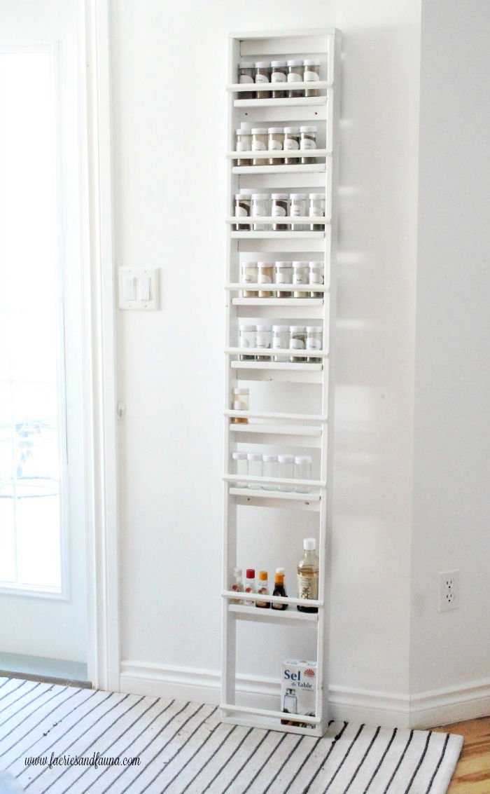 Tall DIY spice rack for a kitchen pantry.