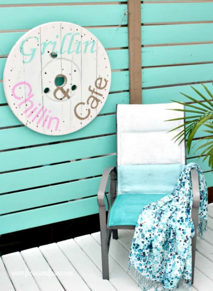 DIY backyard artwork, made from a industrial wood spool. cable Spool ideas, wood cable spool projects, large wooden spool crafts, DIY deck art, DIY deck decor