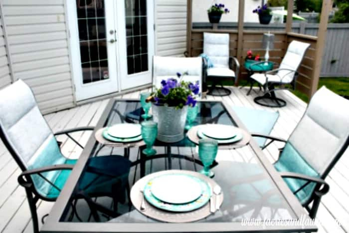 Aqua blue patio furniture restoration, with white and turquoise accessories.