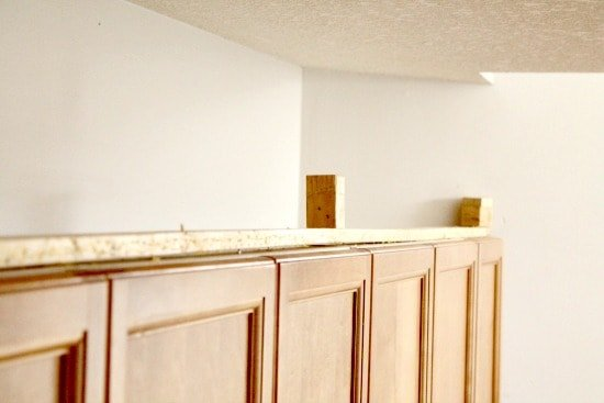How to add moulding to kitchen cupboards. Build a frame before adding the moulding.
