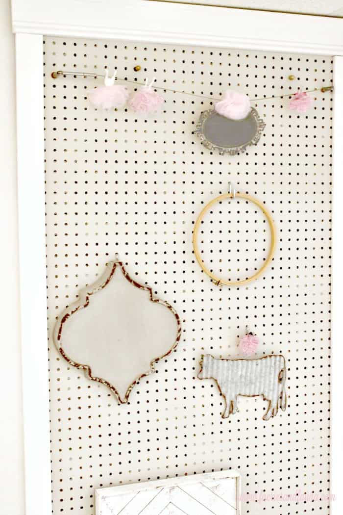 A pretty pegboard for a craft room and some craft pegboard ideas.