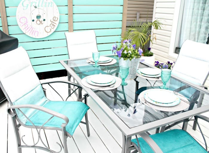 A turquoise dining room set painted in ombre colours as part of a small yard garden tour.