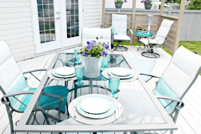 A DIY redone patio in turquoise as part of a small yard garden tour.