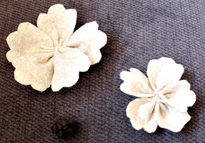 Putting together felt flowers for DIY bedroom art in a Farmhouse style