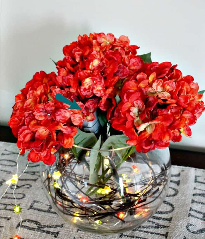 A fall floral centerpiece made with miniature lights. fall themed centerpieces, fall centerpieces DIY ,autumn decorating ideas, fall themed centerpieces, fall floral arrangements