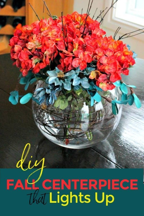 A DIY fall centerpiece in teal and orange that lights up.