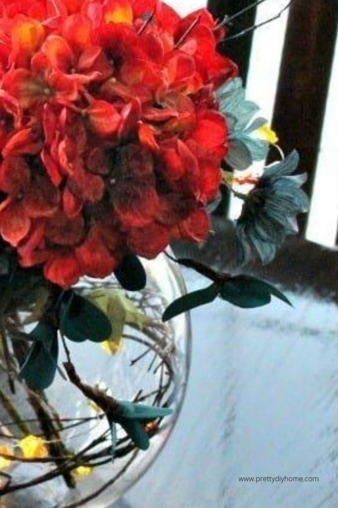 Fall craft idea made with flowers in orange and teal
